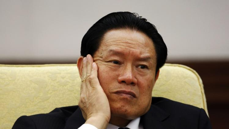 Then China's Public Security Minister Zhou reacts as he attends the Hebei delegation discussion sessions at the 17th National Congress of the CPC in Beijing