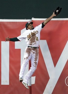 Coco Crisp's leaping catch at the wall gave the A's all the momentum they needed. (AP)