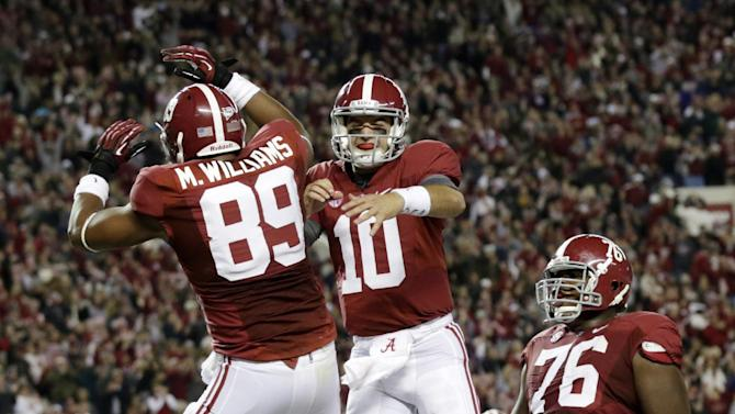 Alabama quarterback AJ McCarron (10) reacts with tight end Michael Williams (89) after throwing him a touchdown pass during the first half of an NCAA college football game against Mississippi State at Bryant-Denny Stadium in Tuscaloosa, Ala., Saturday, Oct. 27, 2012. (AP Photo/Dave Martin)