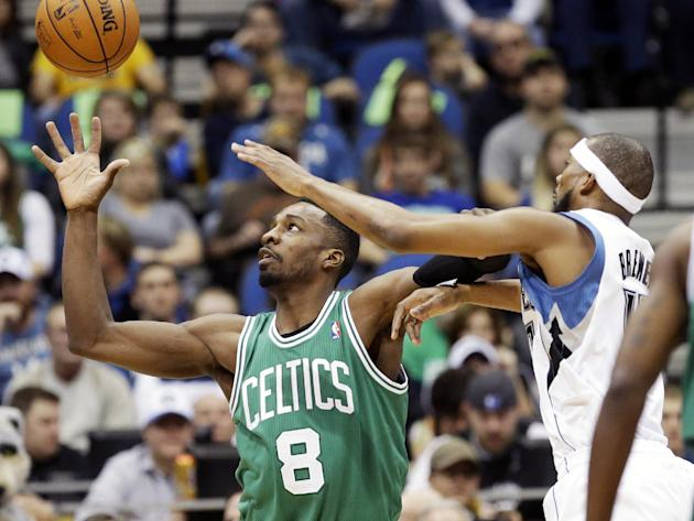 Boston Celtics' Jeff Green, left, reaches for a pass as Minnesota Timberwolves' Corey Brewer defends in the first quarter of an NBA basketball game on Saturday, Nov. 16, 2013, Minneapolis