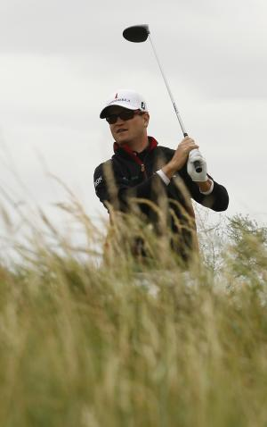 Zach Johnson of the U.S. looks on after his shot on the 4th hole during a practice round ahead of the British Open Golf Championship at Royal St George's golf course in Sandwich, England, Wednesday, July 13, 2011. (AP Photo/Peter Morrison)