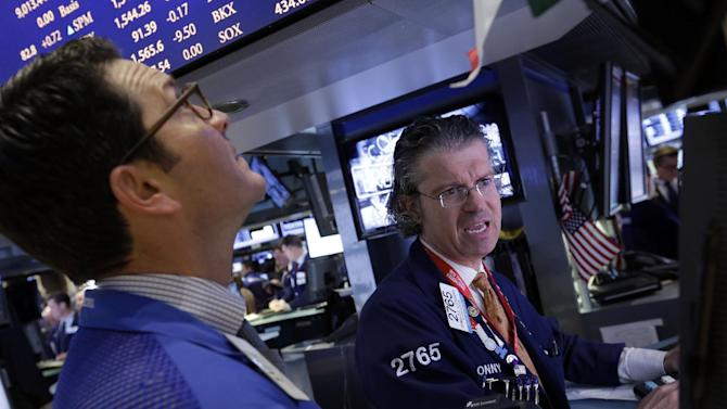 Specialist Donald Civitanova, right, works at his post on the floor of the New York Stock Exchange Friday, March 8, 2013. Stocks are opening higher on Wall Street after the government reported a burst of hiring last month that sent the unemployment rate to a four-year low. (AP Photo/Richard Drew)