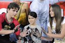 Michael Jackson's children Prince, Blanket and Paris use Jackson's shoes and gloves to make hand and foot imprints in cement in the courtyard of Hollywood's Grauman's Chinese Theatre in Los Angeles