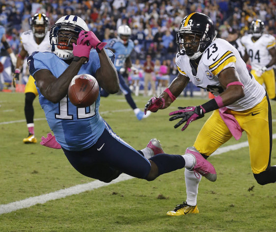Tennessee Titans wide receiver Kendall Wright (13) can't make a catch as Pittsburgh Steelers cornerback Keenan Lewis (23) defends during the first half of an NFL football game Thursday, Oct. 11, 2012, in Nashville, Tenn. (AP Photo/Joe Howell)