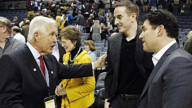Former Memphis Grizzlies majority owner Michael Heisley, left, greets new Grizzlies chairman Robert J. Pera, center, and new CEO Jason Levien following an NBA basketball game between the Grizzlies and the Utah Jazz, Monday, Nov. 5, 2012, in Memphis, Tenn. The Grizzlies won 103-94. (AP Photo/Lance Murphey)