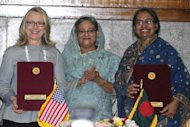 Bangladesh prime minister Sheikh Hasina (C), US Secretary of State Hillary Clinton (L) and Bangladesh Foreign Minster Dipu Moni (R) pose for a photo after signin an agreement in Dhaka, Bangladesh. Clinton was to use a rare visit to Bangladesh Sunday to throw her support behind Muhammad Yunus, the microfinance pioneer and Nobel laureate who has clashed with the state
