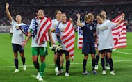 Hope Solo and the United States women's soccer team celebrate after defeating Japan to win the Women's Football gold medal match on Day 13 of the London 2012 Olympic Games on August 9, 2012  -- Getty Images