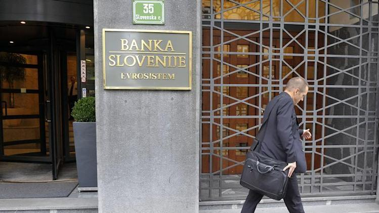 A man walks past Slovenia's Central Bank in Ljubljana