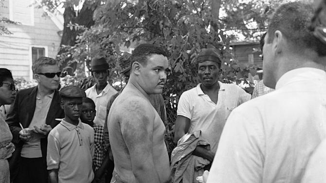 FILE - Lawrence Guyot, 23, of Greenwood, Miss., removed his shirt in Jackson, Miss., to show newsmen where he says Greenwood and Winona police beat him with leather slapsticks, in this June 14, 1963 file photo. His daughter Julie Guyot-Diangone said late Saturday Nov. 24, 2012 he died late Thursday or early Friday outside Washington, D.C. at the age of 73. Guyot, a civil rights leader who survived jailhouse beatings in the Deep South in the 1960s and went on to encourage generations to get involved in various causes,  had a history of heart problems and suffered from diabetes.  (AP Photo/Jim Bourdier, File)
