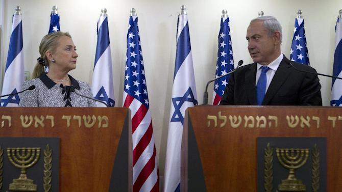 Israel's Prime Minister Benjamin Netanyahu and U.S. Secretary of State Hillary Rodham Clinton deliver joint statements in Jerusalem, Tuesday, Nov. 20, 2012. A diplomatic push to end Israel's nearly weeklong offensive in the Gaza Strip gained momentum Tuesday. (AP Photo/Baz Ratner, Pool)