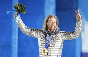 Gold medalist Kotsenburg of the U.S. reacts during the medal ceremony for the men's snowboard slopestyle competition in the Olympic Plaza at the 2014 Sochi Olympic Games