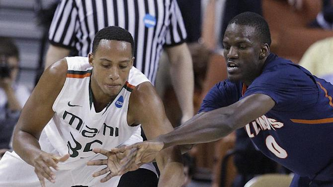 Miami's Kenny Kadji (35) and Illinois' Sam McLaurin go after a loose ball during the second half of a third-round game of the NCAA college basketball tournament Sunday, March 24, 2013, in Austin, Texas. (AP Photo/David J. Phillip)