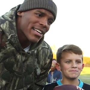 Carolina Panthers quarterback Cam Newton reunites with 'Sunday giveaway' kids