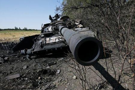 A burnt tank belonging to the Ukrainian forces, according to locals, is seen outside the village of Mnogopolye, southeast from Donetsk