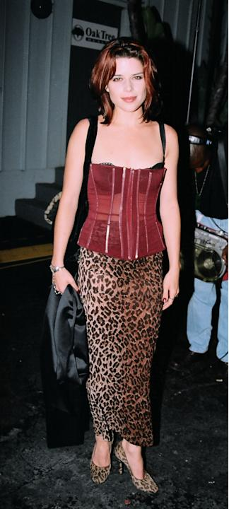 Neve Campbell in a corset and leapord skirt