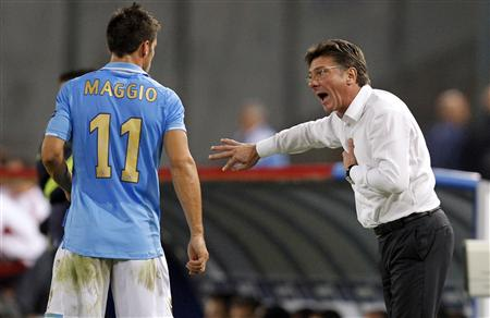 Napoli coach Mazzari gestures near Maggio during the match against Bayern Munich during their Champions League Group A soccer match in Naples