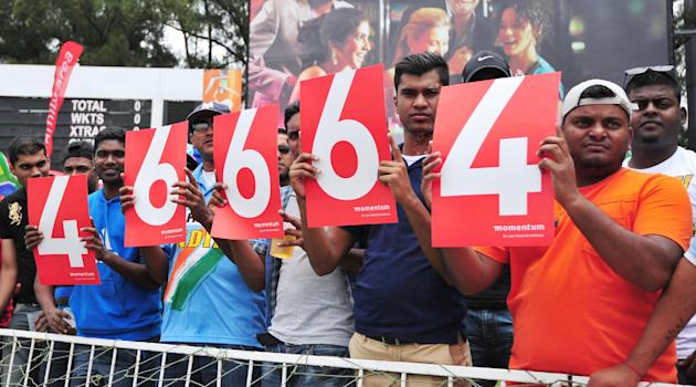 Cricket spectators hold up the prison number of former president Nelson Mandela 's at the ODI cricket match between South Africa and India in Durban South Africa, Sunday, Dec. 8, 2013.  A minutes