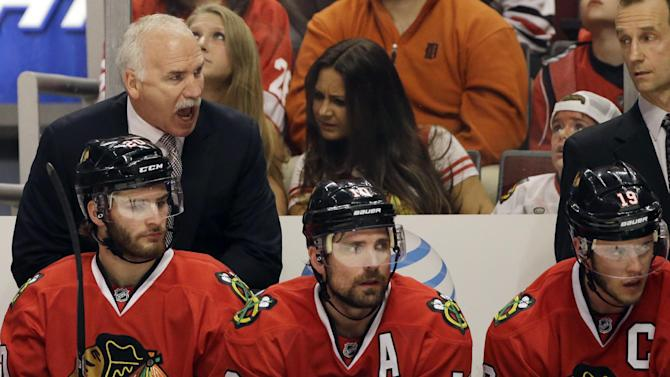 Chicago Blackhawks head coach Joel Quenneville, top left, yells to his team during the second period of Game 5 of the NHL hockey Stanley Cup playoffs Western Conference semifinals against the Detroit Red Wings in Chicago, Saturday, May 25, 2013. (AP Photo/Nam Y. Huh)