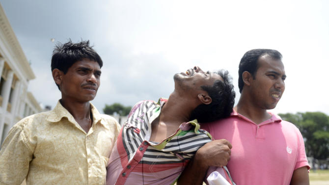 A Bangladeshi man mourns after identifying the body of a relative at a makeshift morgue in Savar, near Dhaka, Bangladesh, Saturday, May 11, 2013. The death toll from Bangladesh's worst industrial disaster is more than 1,000 and climbing. More than 2,500 people were rescued in the immediate aftermath of the April 24 disaster. (AP Photo/Ismail Ferdous)