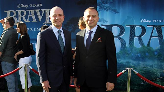 """COMMERCIAL IMAGE - President and CEO of Dolby Laboratories, Kevin Yeaman, left, and EVP of Sales and Marketing of Dolby Laboratories, Ramzi Haidamus, at the Grand Opening of the Dolby Theatre and World Premiere of Disney Pixar's """"Brave"""" on Monday, June 18, 2012 in Los Angeles. (Photo by Matt Sayles/Invision for Dolby/AP Images)"""