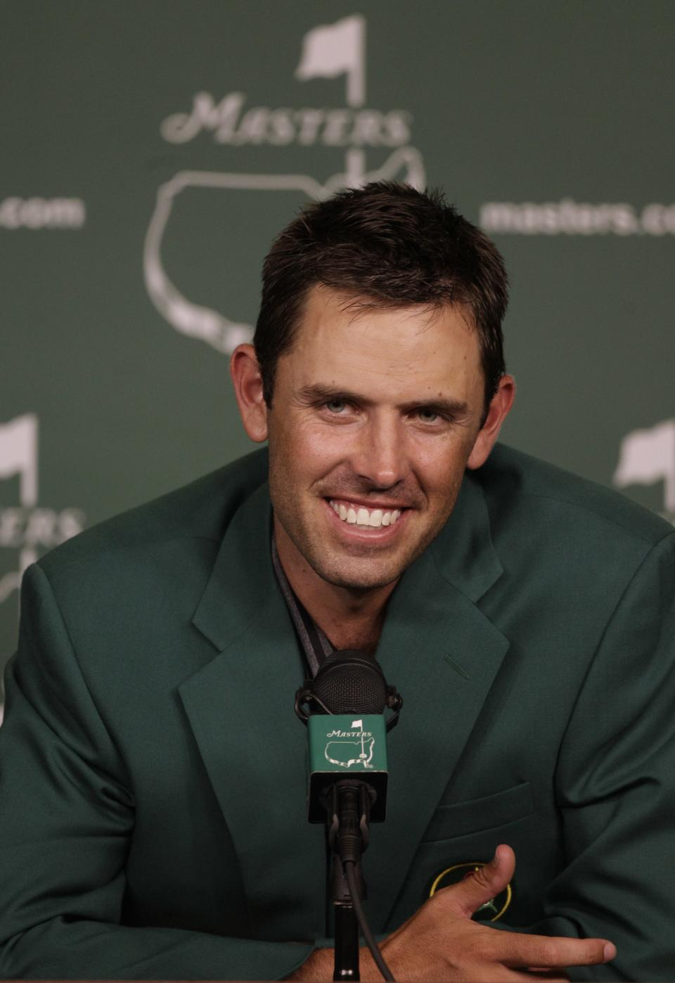 Charl Schwartzel of South Africa speaks to reporters after winning the Masters golf tournament Sunday, April 10, 2011, in Augusta, Ga. (AP Photo/Chris O'Meara)