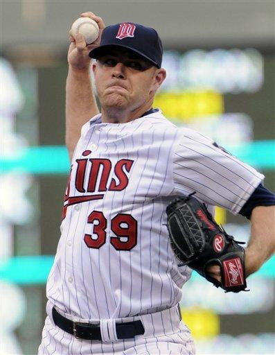 Willingham's single lifts Twins over Cubs in 10th