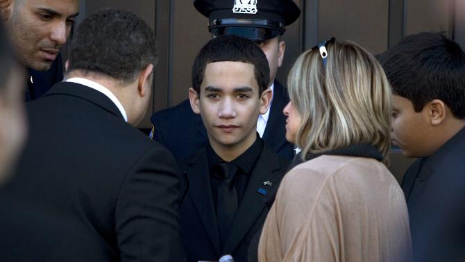 Jaden Ramos, son of slain NYPD officer Rafael Ramos, arrives for his father's wake at Christ Tabernacle Church in the Queens borough of New York