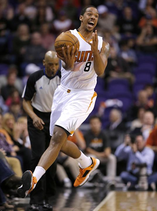 Phoenix Suns' Channing Frye tries to save a loose ball during the first half of an NBA basketball game against the Memphis Grizzlies, Thursday, Jan. 2, 2014, in Phoenix