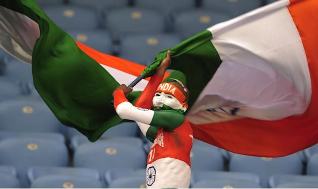 TOPSHOTSAn Indian supporter waves a Indian national flag prior to the one day international (ODI) Asia Cup cricket match between India and Sri Lanka at the Sher-e-Bangla National Cricket Stadium in Dh