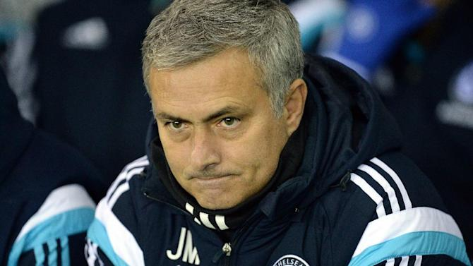 Chelsea manager Jose Mourinho waits for the start of their English League Cup quarter-final match against Derby at iPro Stadium on December 16, 2014