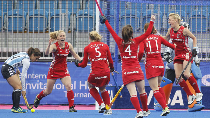 Britain's Crista Cullen, third left, celebrates her penalty corner goal against Argentina with teammates during the women's gold medal field hockey match between Britain and Argentina at the Riverbank field hockey arena in the Olympic Park in London, Sunday, May 6, 2012. (AP Photo/Sang Tan)