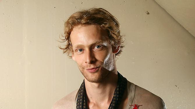 "FILE - This Sept. 14, 2011 file photo shows actor Johnny Lewis posing for a portrait during the 36th Toronto International Film Festival in Toronto, Canada. Authorities say Lewis fell to his death after killing an elderly Los Angeles woman. Lewis appeared in the FX television show ""Sons of Anarchy,"" for two seasons. The woman killed is identified as 81-year-old Catherine Davis. (AP Photo/Carlo Allegri, file)"