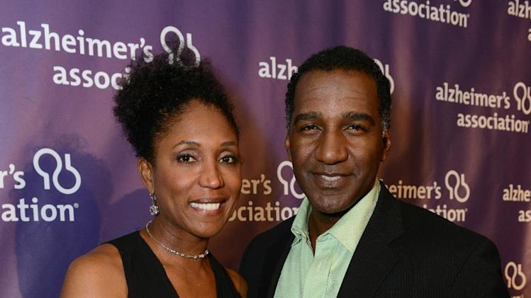 Actor Norm Lewis, right, and a guest arrive at the 21st Annual 'A Night at Sardi's' to benefit the Alzheimer's Association at the Beverly Hilton Hotel on Wednesday, March 20, 2013 in Beverly Hills, Calif. (Photo by Jordan Strauss/Invision for Alzheimer's Association/AP Images)