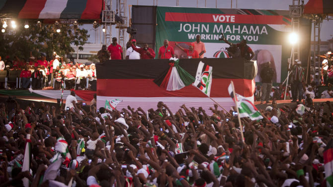 President John Dramani Mahama, top center, stands before cheering supporters during his final campaign rally ahead of Friday's presidential election, in Accra, Ghana, Wednesday, Dec. 5, 2012. After five coups and decades of stagnation, the West African nation of 25 million is now a pacesetter for the continent's efforts to become democratic. Ghanaians will go to the polls on Friday to choose between four candidates, including Mahama, a former vice president who assumed the top post in July after the death of president John Atta Mills, and former foreign minister Nana Akufo-Addo who lost the presidency by less than 1 percent in 2008.(AP Photo/Gabriela Barnuevo)