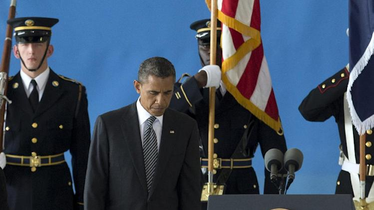 President Barack Obama pauses near the podium during the Transfer of Remains Ceremony, Friday, Sept. 14, 2012, at Andrews Air Force Base, Md., marking the return to the United States of the remains of the four Americans killed this week in Benghazi, Libya. (AP Photo/Carolyn Kaster)