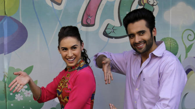 """Bollywood actors Lauren Gottlieb, left, and Jackky Bhagnani attend a promotional event for their upcoming movie """"Welcome to Karachi"""" in New Delhi, India, Friday, May 22, 2015. The film is scheduled to be released on May 29. (AP Photo/Altaf Qadri)"""