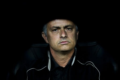 In this Wednesday, March 14, 2012 file photo Real Madrid's coach Jose Mourinho from Portugal looks on before a Champions League round of 16, second leg soccer match against CSKA Moscow's at the Santia