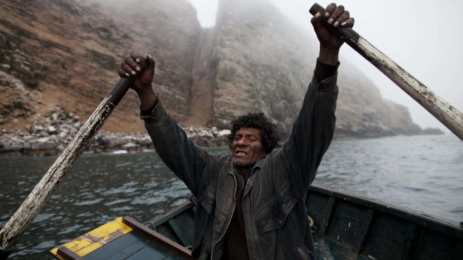 FILE - In this Dec. 1, 2012 file photo, fisherman Alvaro rows a small boat during a fishing expedition in the Pacific Ocean, off the coast of El Callao, Peru. Not only has overfishing of the Peruvian anchovy, or anchoveta, battered the industry that makes Peru far and away the world's No. 1 fish-meal exporter, it has also raised alarm about food security in a nation that had long been accustomed to cheap, abundant seafood. (AP Photo/Rodrigo Abd, File)