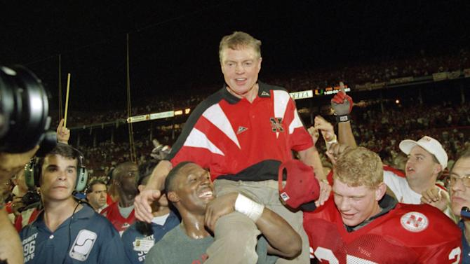 FILE - In this Jan. 1, 1995 file photo, Nebraska players carry coach Tom Osborne off the field after the Huskers defeated Miami 24-17 in the Orange Bowl NCAA college football game in Miami. Osborne will retire as Nebraska's athletic director on Jan. 1, 2013, and end an association with the university that began in 1962. (AP Photo/Doug Mills, File)