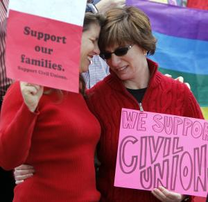 Partners Anna Simon, left, and Fran Simon embrace at a rally in support of Civil Unions at the Capitol in Denver on Tuesday, May 8, 2012. The rally pushed for the passage of a Civil Unions bill that must be debated on the House floor before it can be passed on Wednesday the final day of the Legislative session. (AP Photo/Ed Andrieski)
