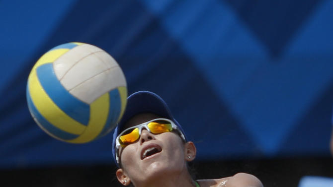 Mexico's Mayra Garcia hits the ball during the women's beach volleyball final match against Brazil at the Pan American Games in Puerto Vallarta, Mexico, Friday, Oct. 21, 2011. (AP Photo/Ariana Cubillos)