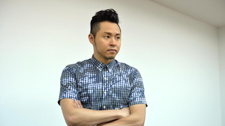 Japan's former Olympic swim king Kosuke Kitajima posing before an interview in Tokyo, July 2, 2014