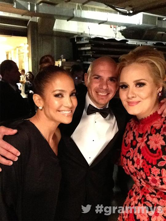 Backstage at the Grammys 2013: Adele posed for a photo with Jennifer Lopez and her boyfriend, Casper Smart backstage at the ceremony. Copyright [The Grammys]