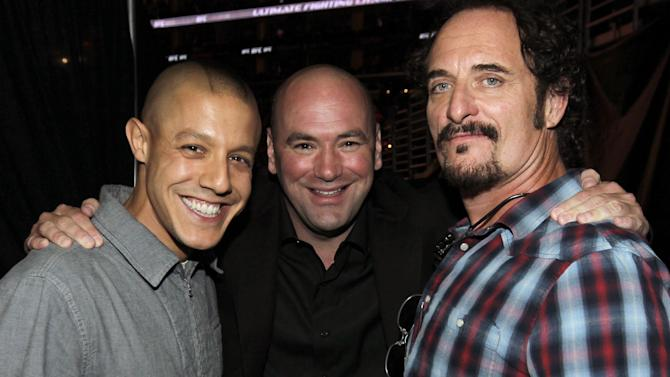 COMMERCIAL IMAGE - Actor Theo Rossi, left, UFC President Dana White, center, and actor Kim Coates attend the UFC on Fox event at Staples Center on Saturday, Aug. 4, 2012, in Los Angeles. (Photo by Matt Sayles/Invision/AP Images)