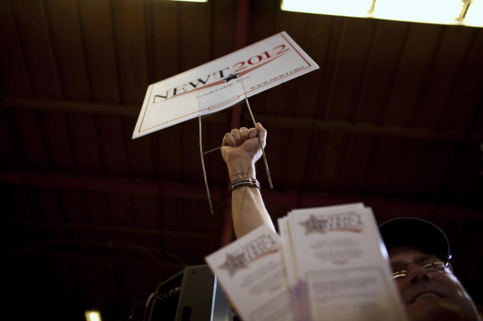 A supporter listens to Republican presidential candidate, former House Speaker Newt Gingrich during a campaign stop at Xtreme Manufacturing, Thursday, Feb. 2, 2012 in Las Vegas.  (AP Photo/Evan Vucci)