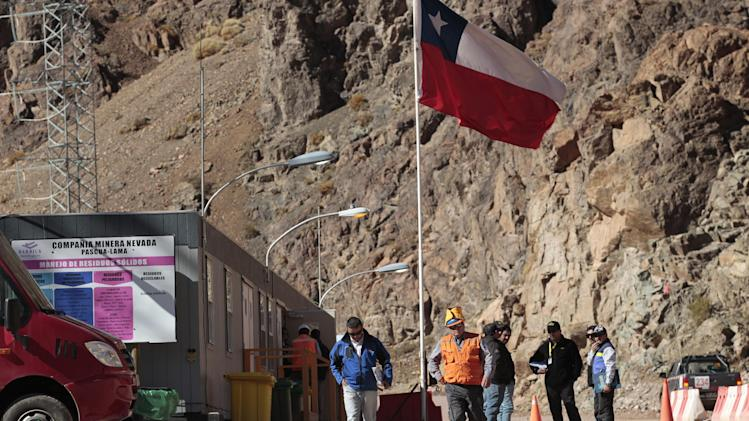 "In this May 23, 2013 photo, security officers walk away from the entrance of the Barrick Gold Corp's Pascua-Lama facilities, in northern Chile. Chile's environmental regulator blocked Barrick Gold Corp.'s $8.5 billion Pascua-Lama project on Friday, May 24, 2013, and imposed its maximum fine on the world's largest gold miner, citing ""very serious"" violations of its environmental permit as well as a failure by the company to accurately describe what it had done wrong. (AP Photo/Jorge Saenz)"