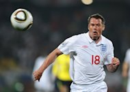 England defender Jamie Carragher eyes the ball during a 2010 World Cup match against USA at the Royal Bafokeng stadium in Rustenburg on June 12, 2010