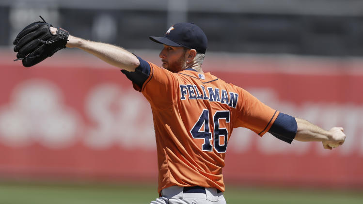 Houston Astros' Scott Feldman works against the Oakland Athletics in the first inning of a baseball game Thursday, July 24, 2014, in Oakland, Calif. (AP Photo)