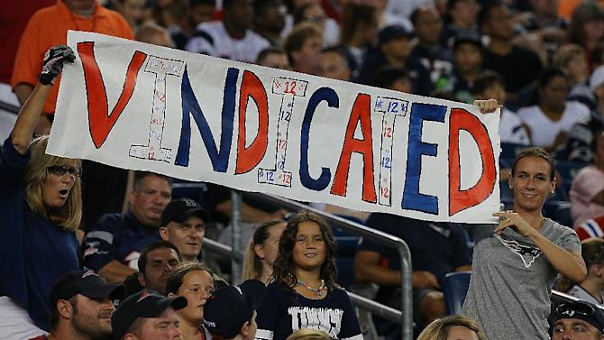 Fans show support Tom Brady of the New England Patriots during a pre-season game with the New York Giants at Gillette Stadium on September 3, 2015 in Foxboro, Massachusetts