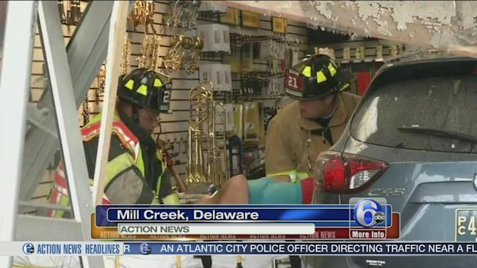 Car plows into music store in Mill Creek, Delaware